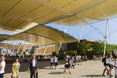 Main EXPO street with many visitors and pavilions on the sides on the Milan EXPO 2015 Stock Images