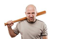 Main fâchée d'homme tenant la batte de sport de base-ball Photo stock
