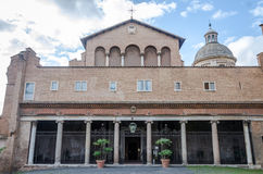 Main facade and entrance to the church of San Giovanni e Paolo with a dome, arches and columns in Rome, capital of Italy Royalty Free Stock Photos