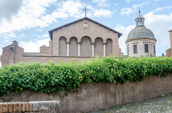 Main facade and entrance to the church of San Giovanni e Paolo with a dome, arches and columns in Rome, capital of Italy Stock Photo