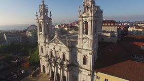 Main facade of the Estrela Basilica in Lisbon at morning aerial view