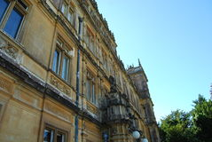 Main facade at Highclere Castle, known popularly as Downton Abbey. Highclere Castle is a country house in the Jacobean style, with a park designed by Capability Royalty Free Stock Photos