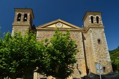 Main Facade Of The New Church Of San Vicente In The Village Of Potes. Nature, Architecture, History, Travel. July 30, 2018. Potes, Cantabria, Spain royalty free stock photo