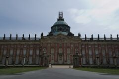 Main facade of the New Palace (Neues Palais), the oldest palace in Sanssouci Park and built just after the end of the Se Stock Images