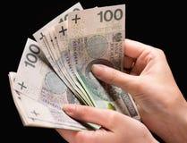 Main femelle avec l'argent photos libres de droits
