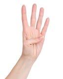 Main femelle montrant le compte quatre Images libres de droits