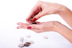 Main femelle tenant l'euro pièce de monnaie Images libres de droits