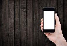Main femelle tenant le téléphone intelligent Photo stock