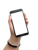 Main femelle tenant un téléphone intelligent noir Images libres de droits