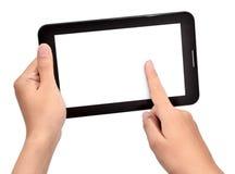 Main femelle utilisant la tablette tactile Photographie stock libre de droits