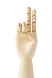 Main fictive en bois avec deux doigts vers le haut Photographie stock
