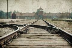 Free Main Gate And Railroad To Nazi  Concentration Camp Of Auschwitz Birkenau. Effect With Grunge Background, Fake Old Photo Stock Photography - 147507732