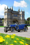 Main gate of the british castle, Lanhydrock. Traditional old car in front of main gate of the british castle, Lanhydrock,UK Royalty Free Stock Photography