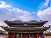 The main gate at Changdeokgung Palace blue sky is a famous tourist attraction in Seoul, South Korea. The main gate at Changdeokgung Palace is a famous tourist stock photography