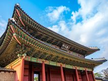 The main gate at Changdeokgung Palace blue sky is a famous tourist attraction in Seoul, South Korea. The main gate at Changdeokgung Palace is a famous tourist stock photos