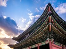 The main gate at Changdeokgung Palace sunshine lighting blue sky is a famous tourist attraction in Seoul, South Korea. The main gate at Changdeokgung Palace stock photo