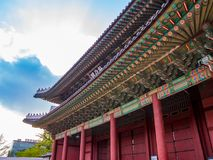 The main gate at Changdeokgung Palace sunshine lighting blue sky is a famous tourist attraction in Seoul, South Korea. The main gate at Changdeokgung Palace royalty free stock photos