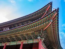 The main gate at Changdeokgung Palace sunshine lighting blue sky is a famous tourist attraction in Seoul, South Korea. The main gate at Changdeokgung Palace royalty free stock images