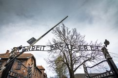 The main gate of the concentration camp Auschwitz with the inscription work makes you free. Auschwitz, Poland, on April 14, 2018. Here took place the Stock Images