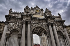 Main gate of the Dolmabahce Palace on a cloudy day Stock Photography