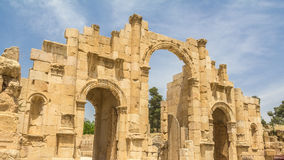 Main gate Hadrian`s Arch in Jerash in Jordan. In front of a blue sky Royalty Free Stock Photos