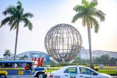Main gate of Mall of Asia with Globe Rotunda in Pasay, Manila, Philippines. Manila, Philippines - Feb 10, 2018 : Main gate of Mall of Asia with Globe Rotunda in Royalty Free Stock Photography