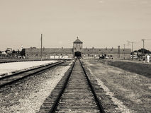 Main gate and railroad in Brzezinka extermination camp Royalty Free Stock Photos