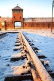 Main gate to nazi concentration camp of Auschwitz Birkenau. Royalty Free Stock Photo