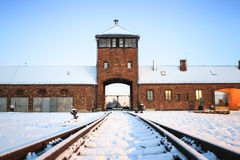 Main gate to nazi concentration camp of Auschwitz Birkenau. Royalty Free Stock Images