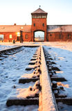 Main gate to nazi concentration camp of Auschwitz Birkenau. Royalty Free Stock Photos