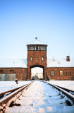 Main gate to nazi concentration camp of Auschwitz Birkenau. Stock Photo