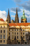 Main gate to the royal area of historical Prague Castle at sunny day, in the background the St Vitus cathedral, Czech Republic Stock Photography