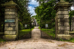 Main gates to a mansion in the distance Royalty Free Stock Photos