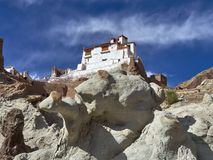 The main gong of the buddhist Basgo monastery: a white building with a red roof stands on a white rock cliff, Ladakh, Himalayas, I Stock Image