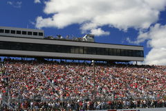Main Grandtsand at NHIS. Fans along the front stretch waiting the start of the 2007 NASCAR Race for the Chase at New Hampshire International Raceway Royalty Free Stock Photo