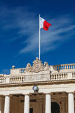 Main Guard. Facade with Maltese flag on top, Palace Square, Valletta, Malta Royalty Free Stock Photography