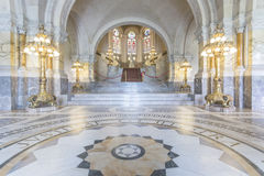 Main Hall of the Peace Palace. Decorated with golden lanterns with a marble staircase leading to the first at both side stock photo