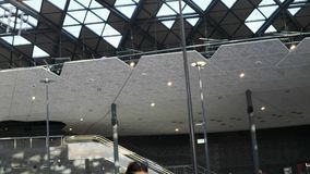 Main hall of the train or bus station. Large modern main hall or lobby of train or bus station, airport with passengers, girl waits for her flight and looks at stock footage