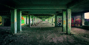 Main Hall. View of one of the long corridors of an abandoned hospital, details of all graffiti Royalty Free Stock Photos