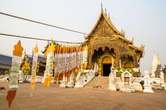 The main hall of Wat Baan Den, a famous Buddhist temple in Maetaeng, with rows of Lanna flags hanging in front. stock photos