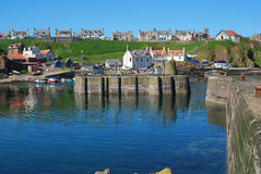 The main harbour, boats, slipways and village at St. Abbs, Berwi Royalty Free Stock Photography