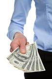Main humaine atteignant à l'extérieur l'argent Image libre de droits