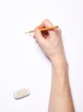 Main humaine avec le crayon et la gomme à effacer Photographie stock libre de droits