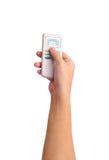 Main humaine avec un à télécommande Image stock
