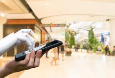 Main humaine de transition robotique d'intelligence artificielle à la presse de main de robot le bouton de smartphone images stock