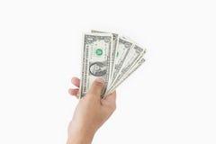 Main humaine donnant l'argent Image libre de droits