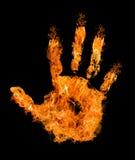 Main humaine en flamme orange sur le noir Photo stock