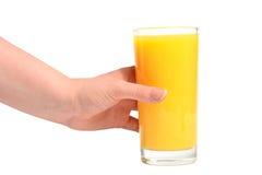 Main humaine et orange juteuse fraîche Photos stock