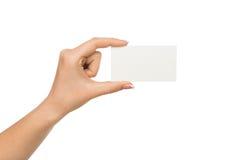 Main humaine tenant la carte vierge pour le message textuel Image libre de droits