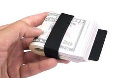 Main humaine tenant le billet d'un dollar américain comme argent d'isolement sur le blanc Photographie stock libre de droits